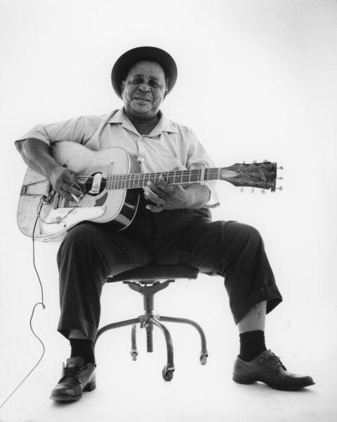 big joe williams holding his nine-string guitar