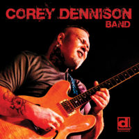 "Album Cover - Top Text Says ""Corey Dennison Band"" Photo of Corey Dennison playing an electric guitar, in bottom right corner is Delmark Logo"