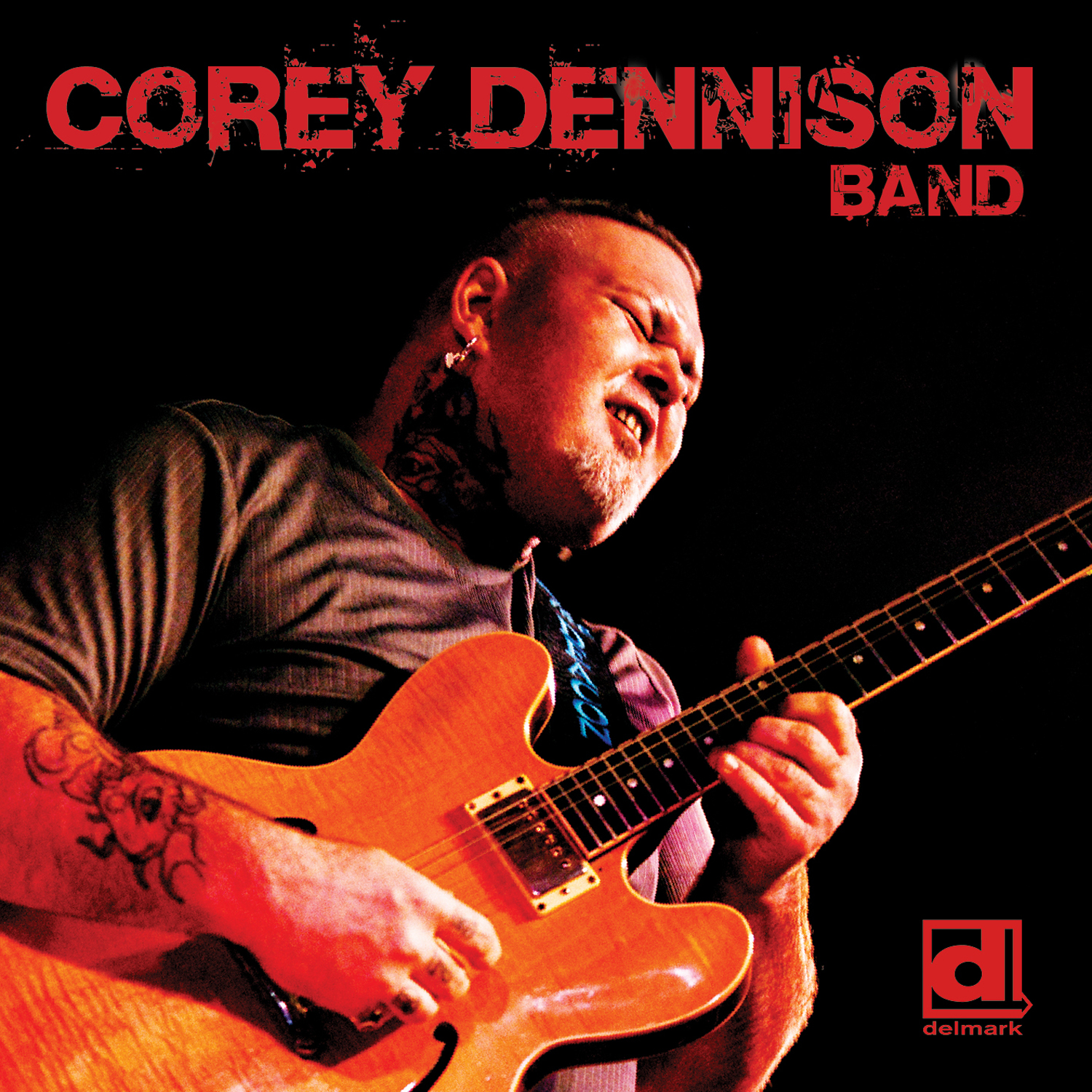 """Album Cover - Top Text Says """"Corey Dennison Band"""" Photo of Corey Dennison playing an electric guitar, in bottom right corner is Delmark Logo"""